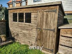Garden Shed. Tanalised Deluxe loglap Pent Shed 10 x 8