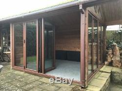Timber summer house/ garden cabin with bifold doors and adjoining shed