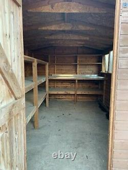 USED Wooden Garden Shed 12' x 8'. Workbench and Shelving Inside. Two Windows