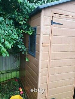 Used Plastic Brown 5.9ft x 4.10ft Garden Shed with Window