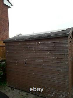Wooden garden shed 8ft x 6ft heavy duty with apex roof (needs covering again)